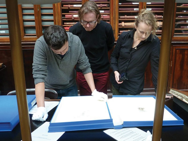 Tom Nicholson, Martin King and Caroline Rothwell viewing old master prints in the British Museum.